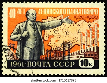 Moscow, Russia - April 22, 2020: stamp printed in USSR (Russia), shows Vladimir Lenin on power stations background, dedicated to Lenin Plan of Electrification of Russia, circa 1961