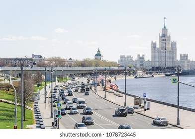 Moscow, Russia - April 23, 2018: Moskvoretskaya embankment. The view of the fragment of the unique floating bridge in the Park Zaryadye and Stalin skyscraper on the Kotelnicheskaya embankment. Spring