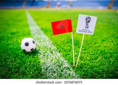 MOSCOW, RUSSIA - APRIL, 24, 2018: Morocco national flag and Official logo of Football FIFA World Cup 2018 in Russia.
