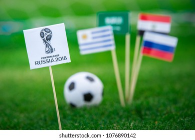 MOSCOW, RUSSIA - APRIL, 24, 2018: Group A - National flags of Russia, Saudi Arabia, Egypt, Uruguay and Official logo of FIFA World Cup 2018 in Russia. White background, edit space.