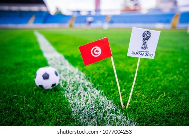 MOSCOW, RUSSIA - APRIL, 24, 2018: Tunisia national flag and Official logo of Football FIFA World Cup 2018 in Russia.
