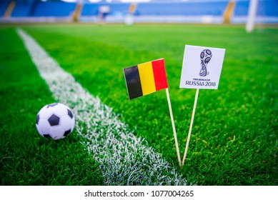 MOSCOW, RUSSIA - APRIL, 24, 2018: Belgium national flag and Official logo of Football FIFA World Cup 2018 in Russia.