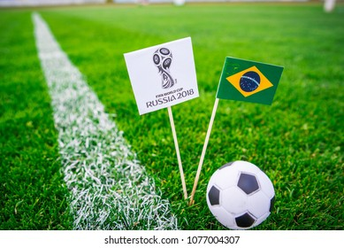 MOSCOW, RUSSIA - APRIL, 24, 2018: Brazilian national flag and Official logo of Football FIFA World Cup 2018 in Russia.
