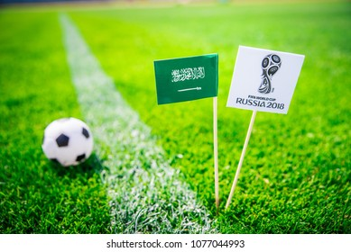 MOSCOW, RUSSIA - APRIL, 24, 2018: Saudi Arabia national flag and Official logo of Football FIFA World Cup 2018 in Russia.