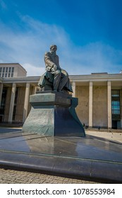 MOSCOW, RUSSIA- APRIL, 24, 2018: Outdoor view of The Russian state library. Monument to the writer F. M. Dostoevsky