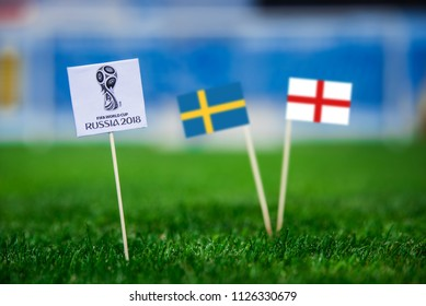 MOSCOW, RUSSIA - APRIL, 24, 2018: Sweden - England, Quarterfinal. 7. July, Football FIFA World Cup, Russia 2018, National Flags on green grass, white football ball on ground. Play-off