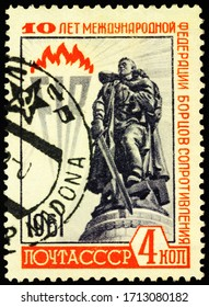 Moscow, Russia - April 24, 2020: stamp printed in USSR (Russia), shows monument to Soviet soldier in Treptower Park, Berlin, dedicated to International Federation of Resistance Fighters, circa 1961