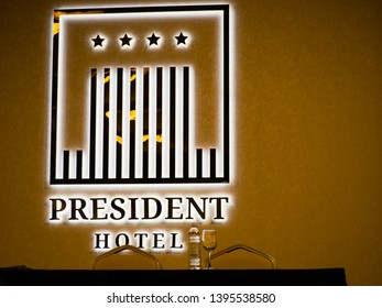 MOSCOW, RUSSIA - APRIL 25, 2019: Presidium table and illuminated logo in the conference hall of the President Hotel in Moscow, Russia on April 25, 2019.