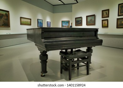 MOSCOW, RUSSIA - APRIL 25, 2019: Exhibition hall of the Museum of Russian impressionism in Moscow. Black piano in the hall