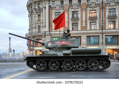 MOSCOW, RUSSIA - April 26, 2018 Soviet T-34 tank with waving red banner at beginning of Tverskaya street before the beginning of 1st Night Rehearsal of 2018 Moscow Victory Day Parade on Red Square
