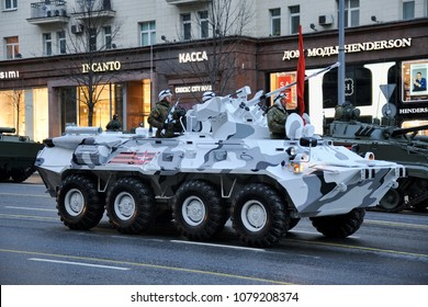 MOSCOW, RUSSIA - April 26, 2018 Russian troopers in the arctic version of the BTR-82A with a 30-mm cannon 2A72 on Tverskaya street before beginning of night rehearsal of the parade on Red Square