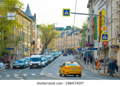 Moscow, Russia - April, 27, 2019: image of yellow taxi on Moscow street in Moscow