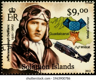 Moscow, Russia - April 27, 2021: stamp printed in Solomon Islands, shows Jefferson J. DeBlanc, American WWII Marine Corps fighter pilot and flying ace, series WWII Guadalcanal Campaign, circa 2012