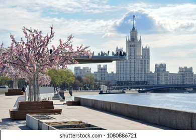 MOSCOW, RUSSIA - April 29, 2018 At Moskvoretskaya Embankment in Early Spring Sunny Morning, people enjoying the nice spring weather, walking and taking pictures on floating bridgge of park Zaryadye