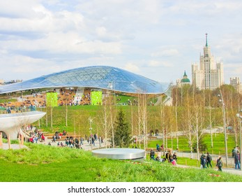 Moscow, Russia - April 29. 2018. People are walking in park Zaryadye against the background of glass bark.