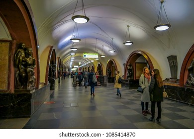 MOSCOW, RUSSIA- APRIL, 29, 2018: Indoor view of unidentified people walking close to the bronze sculpture in Ploshchad Revolyutsii subway station