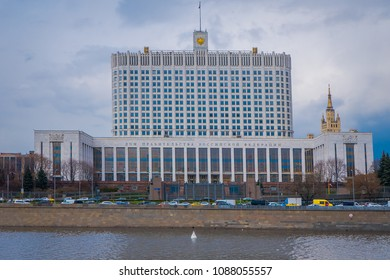 MOSCOW, RUSSIA- APRIL, 29, 2018: Russian White House on sunny summer day, official workplace of the Russian Prime Minister. Text on facade: House of the Government of the Russian Federation