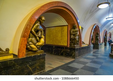 MOSCOW, RUSSIA- APRIL, 29, 2018: Tourist walking in a subway metro station in Ploshchad Revolyutsii, with a gorgeous bronze sculpturin the corner of the arch inside the building in Moscow