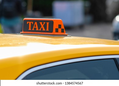 Moscow, Russia - April, 29, 2019: yellow taxi on Moscow street