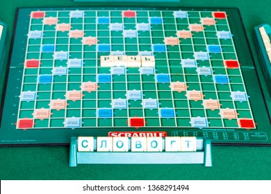 MOSCOW, RUSSIA - APRIL 3, 2019: gameboard of russian edition of Scrabble board game on green table. Scrabble is a word game, it was designed by Alfred Mosher Butts and first published in 1938