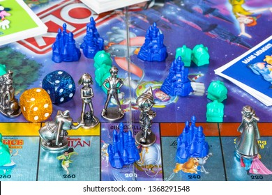 MOSCOW, RUSSIA - APRIL 3, 2019: figurines of Monopoly game, Disney edition. Monopoly is a board game that is currently published by Hasbro in 1935, it was designed by Lizzie Magie and Charles Darrow