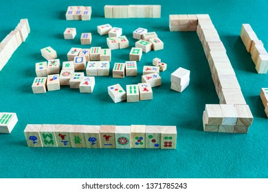MOSCOW, RUSSIA - APRIL 3, 2019: playing in mahjong game, tile-based chinese strategy board game on green baize table