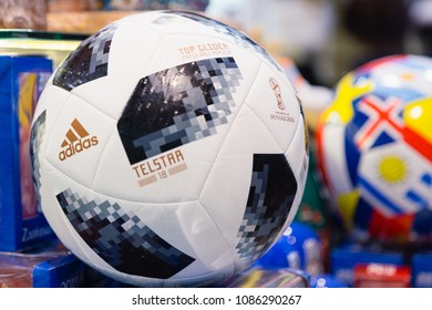 MOSCOW, RUSSIA - APRIL 30, 2018: Copy of a soccer ball with inscription TOP GLIDER match ball replica and TELSTAR emblem and ADIDAS logo of the World Cup FIFA 2018 mundial in the souvenir shop.