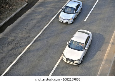 MOSCOW, RUSSIA - APRIL 30: Top view of two cars on highway on April 30, 2018.