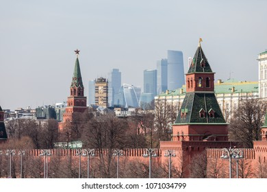 MOSCOW, RUSSIA - APRIL 5, 2018: Famous Russian historical Grand Kremlin Palace, Walls and Towers in front of modern Moscow International Business Center (MIBC) skyscrapers at Moscow City.