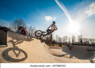 Moscow, Russia - April 6, 2017: Young bicyclist is doing tricks  at the Gorky park