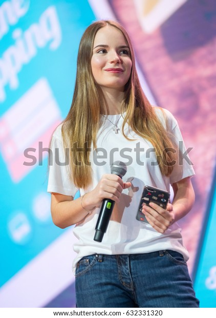 """Moscow, Russia - April 7, 2017: Famous Russian blogger and vlogger Sasha Spilberg on the stage. Conference """"Traffic. Applications. Sales"""" Moscow, Russia April 7, 2017"""