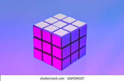 Moscow, Russia - April 8, 2018: Rubik's cube on the lilac-blue background, ultra violet toned. Puzzle Rubik's Cube, called the Magic Cube, invented by a Hungarian architect Erno Rubik in 1974.