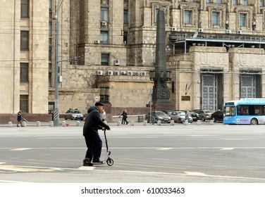 MOSCOW, RUSSIA - APRIL 9, 2016:The man on the scooter on Smolensk square in Moscow.