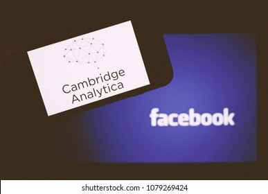 Moscow, Russia - April,29: The logo of the strategic communication company Cambridge Analytica is seen on the screen of an iPhone in front of a computer screen showing Facebook logo