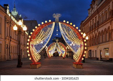 MOSCOW, RUSSIA - The attractive arches in the middle of pedestrian Old Arbat street resemble illuminated mirrors in the make-up room in morning twilight.