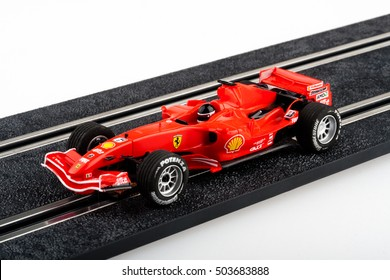Moscow, Russia - Aug 14, 2010: Slot car racing track with red formula one car.