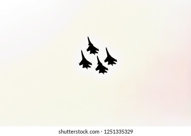 """MOSCOW, RUSSIA - AUG 2015: Aerobatic display team """"Falcons of Russia"""" on Su-27 and Su-34 at the 12th MAKS-2015 International Aviation and Space Show on August 28, 2015 in Moscow, Russia"""