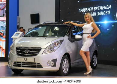 Moscow, Russia - Aug 24, 2016: Gool girl near Ravon R2 (new Daewoo Matiz) at MIAS 2016, Moscow Russia