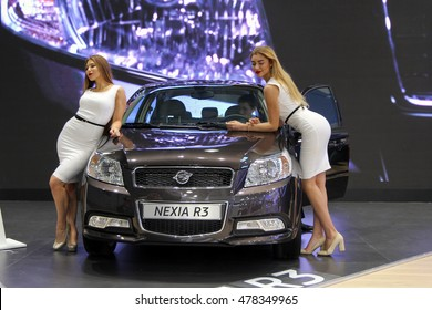 Moscow, Russia - Aug 24, 2016: Gool girls near Ravon Nexia R3 (new Daewoo Nexia) at MIAS 2016, Moscow Russia