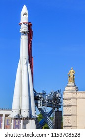 Moscow, Russia - August 01, 2018: Vostok booster rocket on VDNH in Moscow on a background of pavilions Transport and Space in sunny summer morning against blue sky