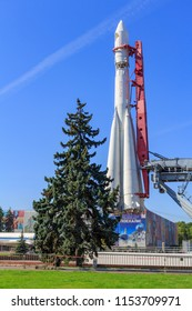 Moscow, Russia - August 01, 2018: Vostok booster rocket on a background of green spruce on Exhibition of Achievements of National Economy (VDNH) in Moscow