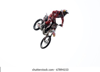 MOSCOW, RUSSIA - AUGUST 01:Alexey Kolesnikov performs 'whip maneuver' during FMX contest at Triumph Square  on August 1, 2010 in Moscow, Russia.