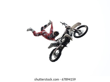 MOSCOW, RUSSIA - AUGUST 01:Alexey Kolesnikov performs 'Executioner maneuver' during FMX contest at Triumph Square  on August 1, 2010 in Moscow, Russia.