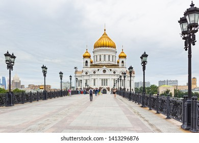 MOSCOW, RUSSIA - August 04, 2017. View of Cathedral of Christ the Savior. People walking on Patriarshiy bridge.