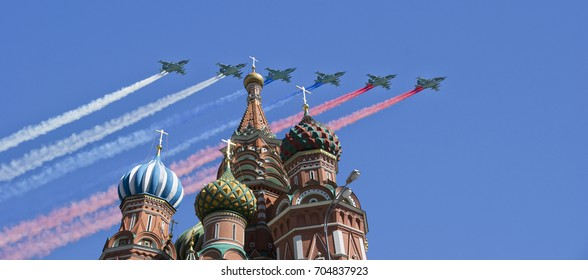 MOSCOW, RUSSIA- AUGUST 06, 2017: Russian military aircrafts fly in formation over Moscow(Saint Basil cathedral) during Victory Day parade, Russia