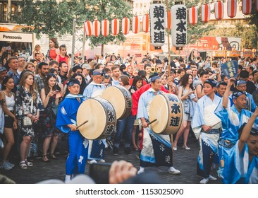 Moscow, Russia - August 09, 2018: Japanese artist perform at Bon Festival in blue kimono with big drum odaiko on festival of Japan. Drummer performance on Taiko Drum