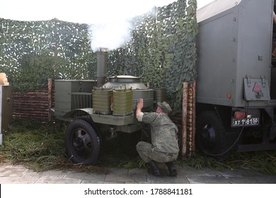 MOSCOW, RUSSIA – AUGUST 1, 2020: Mobile military field kitchen. Patriot Park in Moscow city, Russia. Meal, food in russian style. Military, conscription. Conscript soldier. Russian Armed Forces, army