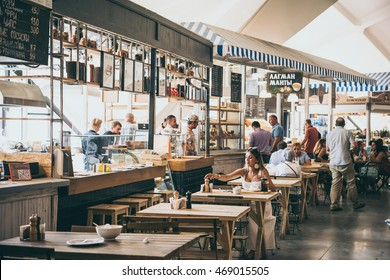 MOSCOW, RUSSIA - AUGUST 10, 2016: View of different street food shops at Danilovsky market in Moscow, Russia. Toned picture