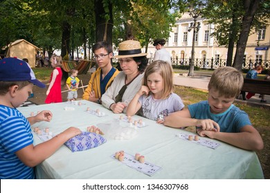MOSCOW, RUSSIA - AUGUST 10, 2018:  Adults and children play Russian Lotto (Bingo)