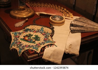 """MOSCOW, RUSSIA - AUGUST 11, 2013: Women's accessories: handbag, fan, jewelry box, ladies gloves, bottle with smelling salt.  The exhibition """"Fashion in the mirror of history. 19th - 20th century."""""""